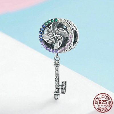 Pinwheel And Key Charm